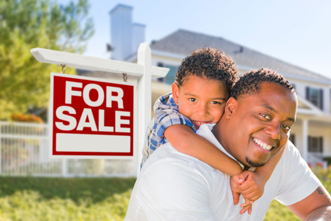 Father and son in front of home purchased with the legal help of an Edmonton real estate lawyer in the law firm Coley Hennessy Cassis